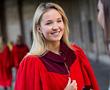 Girl in red robe